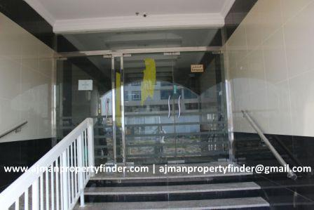Building entrance flat for rent in Al Zahra Area Ajman