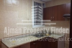 1 BHK in Mandarin Towers Garden City ajman - Kitchen View